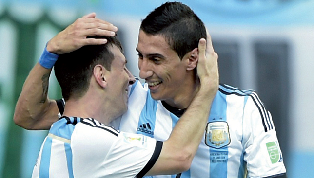 Dynamic duo: Di Maria with Messi after his last-minute strike saw Argentina beat Iran 1-0.