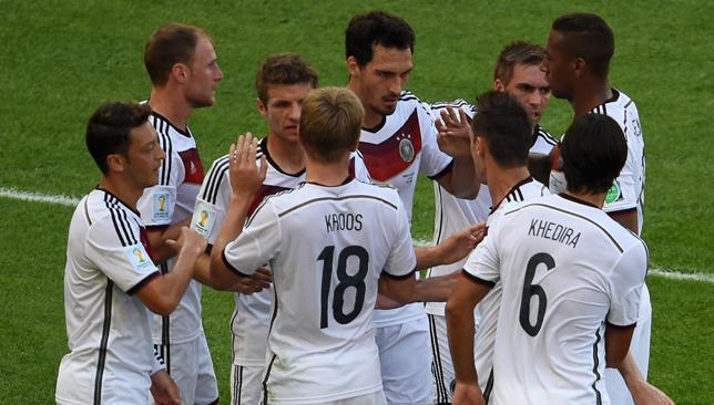 Head of the class: Hummels (c) is mobbed by teammates for his winning goal.