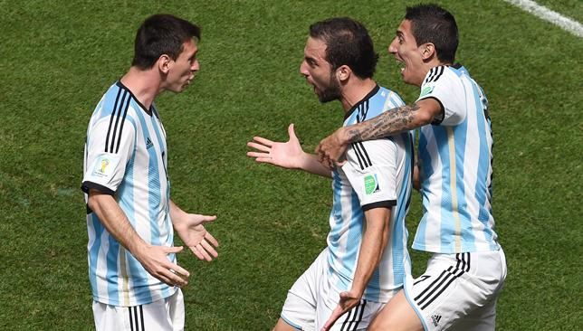 Sharing the burden: Higuain (c) celebrates his goal with Messi (l) and Di Maria (r).