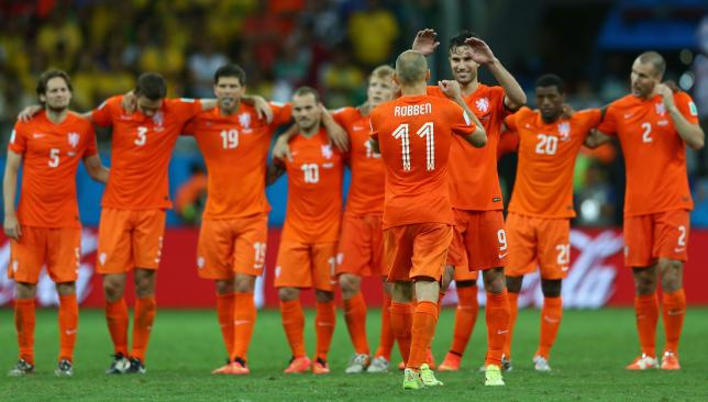 Netherlands united: The Dutch players celebrate after beating Costa Rica on penalties, in contrast to previous teams that have been riven by poor morale.