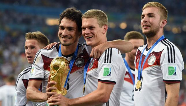 History boys: Hummels (l) proudly grasping the cup.