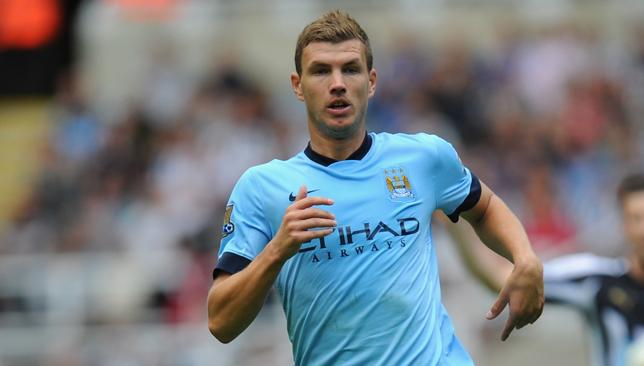 Grounded: Dzeko and Man City got their title defence underway with a victory.