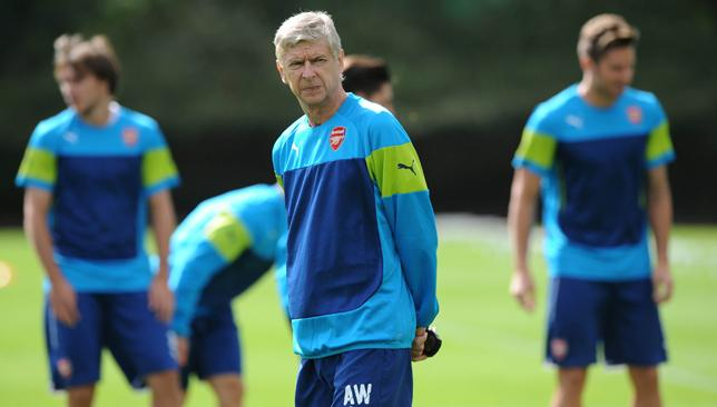 Up for the fight: Wenger urges his Arsenal troops to be prepared for battle at Everton.