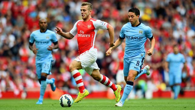 Spoils shared: Wilshere scored Arsenal's first in the draw against Man City.