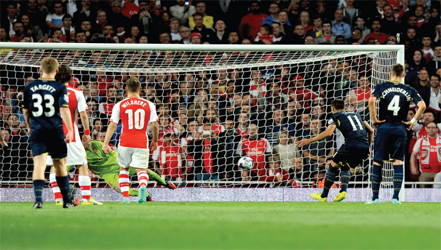 Paying the penalty: The excellent Dusan Tadic strokes home from the spot to give Southampton the lead at the Emirates.