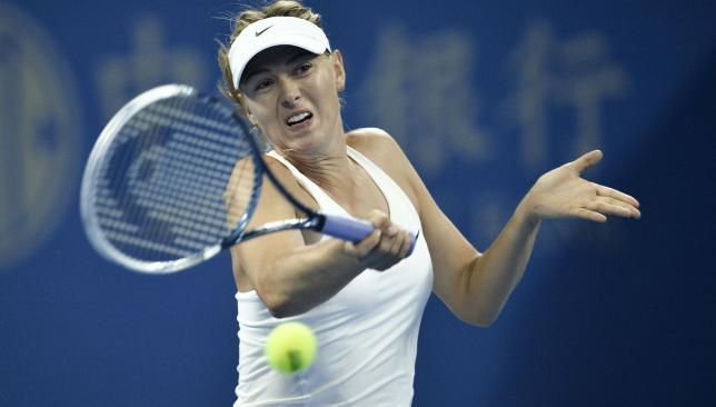 Convincing win: Maria Sharapova won in straight sets against Carla Suarez Navarro.