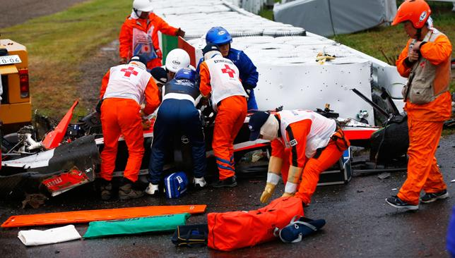Crash site: Jules Bianchi is attended to by stewards and medics.