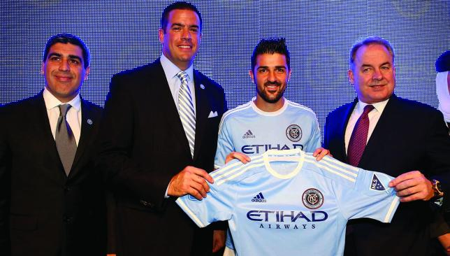 New colours: David Villa helps unveil the NYCFC in New York last week.