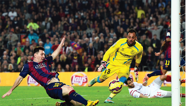 Messi magic: The Argentine scores his second and Barca's fourth against Sevilla.