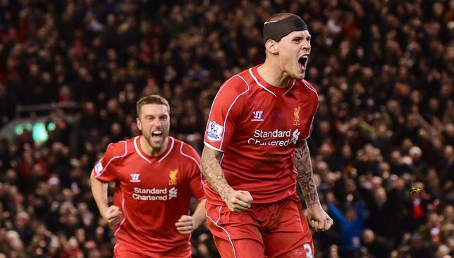 Star man: Liverpool's Slovakian defender Martin Skrtel (R) celebrates scoring his team's second equalising goal at Anfield.