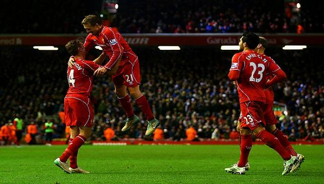 Jordan Henderson celebrates with his teammates after Jonjo Shelvey's own goal during Liverpool's 4-1 win over Swansea.