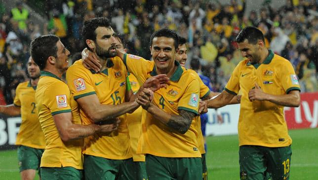 Happy hosts: Australia's Mathew Leckie (L) congratulates Mile Jedinak (C) and Tim Cahill (R) after a goal during the first round Asian Cup football match against Kuwait.