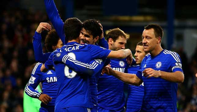 On fire: Diego Costa (c) is congratulated by team-mates after scoring.
