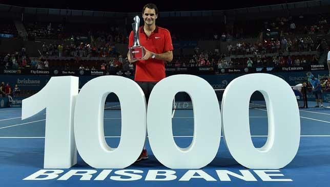 Memorable win: Roger Federer celebrated his 1000th career win and Brisbane International title after beating Milos Raonic.