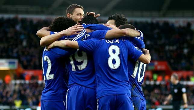 Happy camp: Chelsea players celebrate their opener against Swansea.