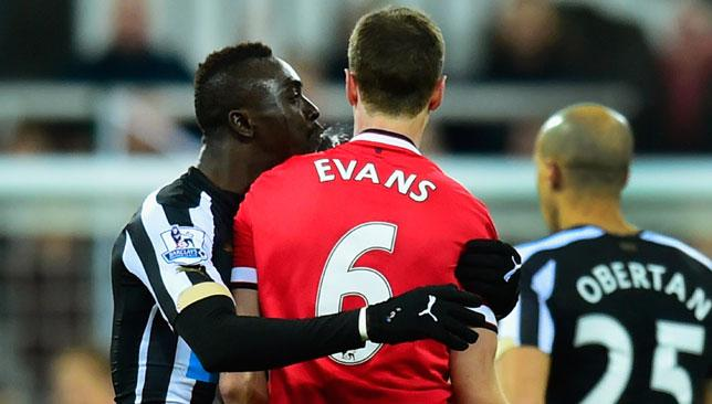 Cisse (l) is caught by cameras appearing to spit at Evans after feeling the latter had done the same to him.