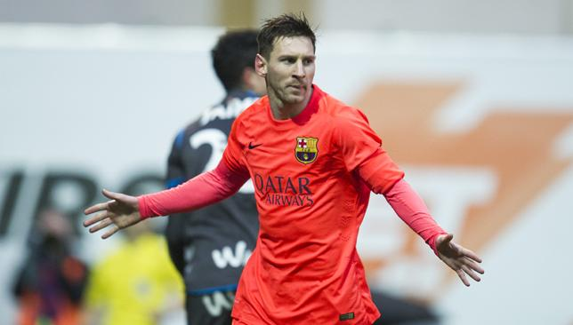 Danger man: Lionel Messi celebrates after scoring against Eibar.