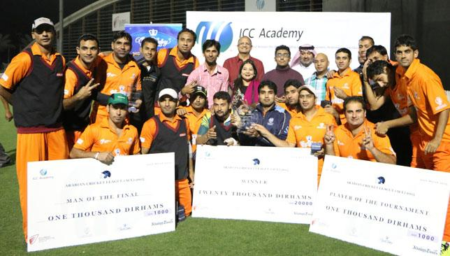 Danube Lions celebrate victory in the Arabian Cricket League at the ICC Academy.