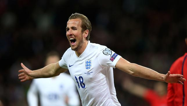 Flying high: Harry Kane scores at Wembley in his first senior England appearance.