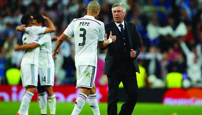 Job well done: Carlo Ancelotti congratulates Pepe at the final whistle.