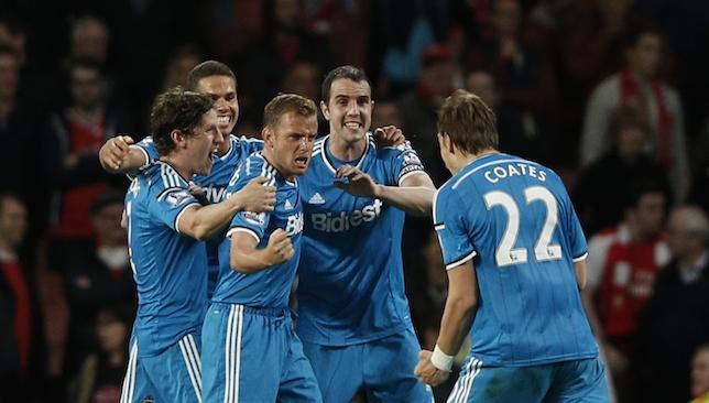 Safe: Sunderland celebrate.