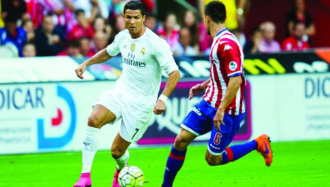 Not hitting the target: Cristiano Ronaldo takes on Sporting's Sergio Alvarez.