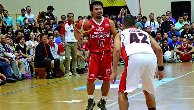 New ball game: Manny Pacquiao in action for Mahindra Enforcers.