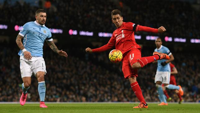 Roberto Firmino shoots at goal during the game against Manchester City.